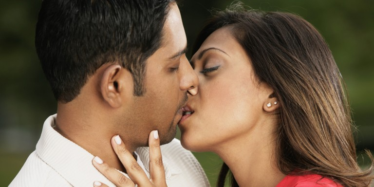Close-up of a young couple kissing